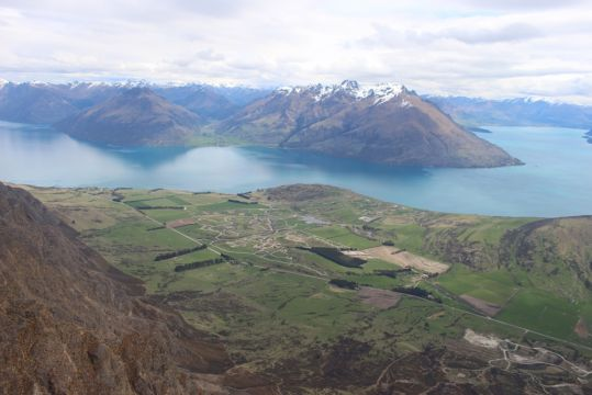 Lake Wakatipu and Queenstown from helicopter. This scenery depicts the South Island and Middle Earth for touring best by motorbike.